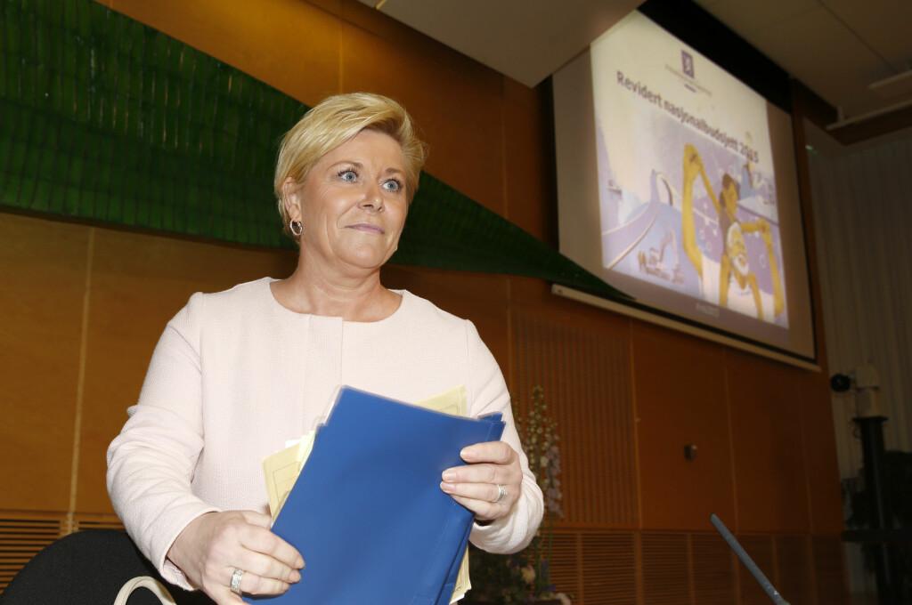 Finansminister Siv Jensen legger denne uka fram revidert nasjonalbudsjett. Bildet er fra samme anledning i fjor. Foto: TERJE PEDERSEN/NTB SCANPIX