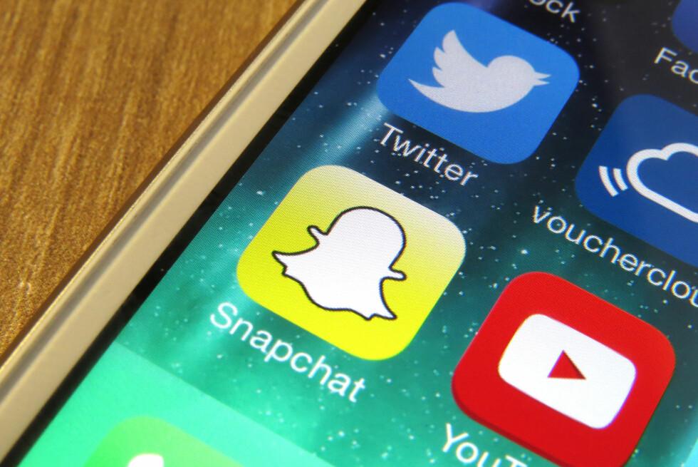 IKKE LENGER BARE FOR UNGDOMMEN: Stadig flere tar i bruk meldingsappen Snapchat. Foto: PA PHOTOS