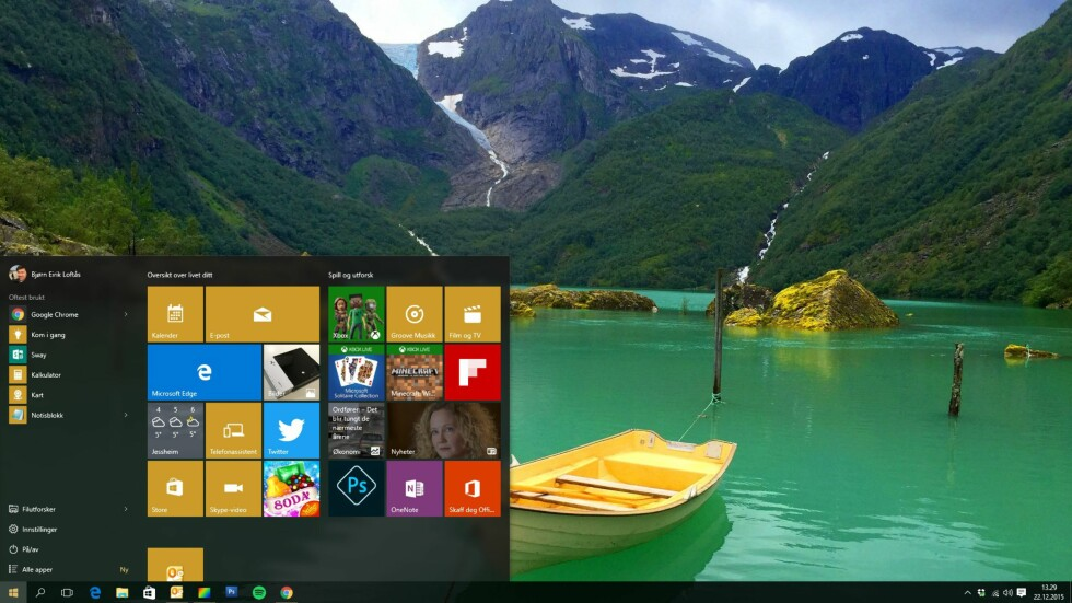 Slik ser skrivebordet ut med Windows 10-menyen, og ...