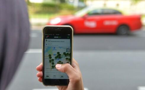 TAR OPP KAMPEN Mivai skal nå ta opp kampen mot Ubers app (bildet) på for å rettferdiggjøre og modernisere Norges taxinæring.  Foto: NTB SCANPIX / AFP