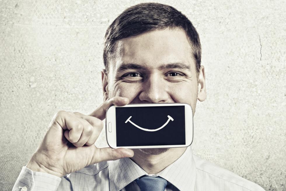 UPROFESJONELT?  Å bruke smilefjes i jobb-mail kan få deg til å fremstå useriøs.  Foto: SERGEY NIVENS / NTB scanpix