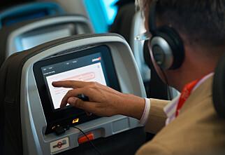 Bruk egne hodetelefoner på flyet