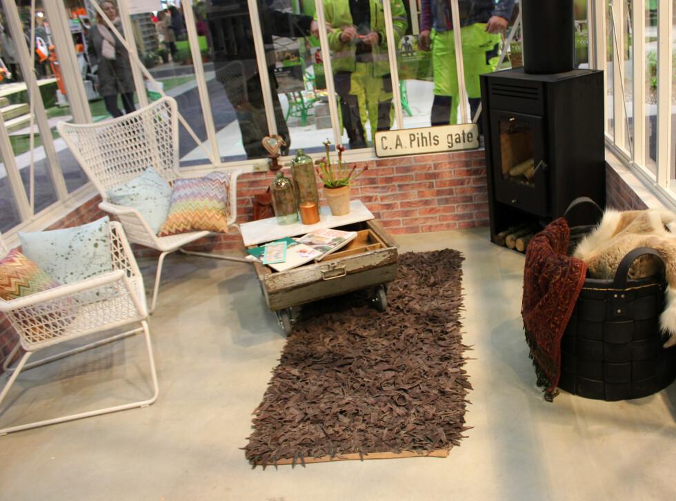 PEIS: Hvorfor ikke jazze opp drivhuset med en peis? Drivhus fra Paviljong Norge. Foto: KRISTIN SØRDAL