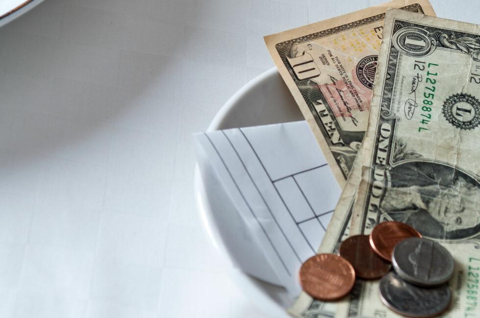 20 PROSENT: Ifølge Ving uttrykker du hvor fornøyd du er med hvor mye tips du gir. 10 prosent betyr at du er misfornøyd med maten og servicen. Foto: SCANPIX