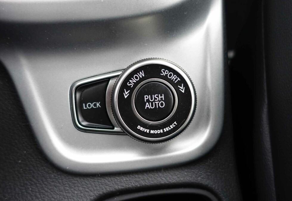 FIRE KJØREPROGRAMMER: Med denne bryteren stiller man inn bilens ønskede oppførsel. Foto: KNUT MOBERG