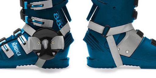 image: Lei av å bære rundt på tunge alpinski?