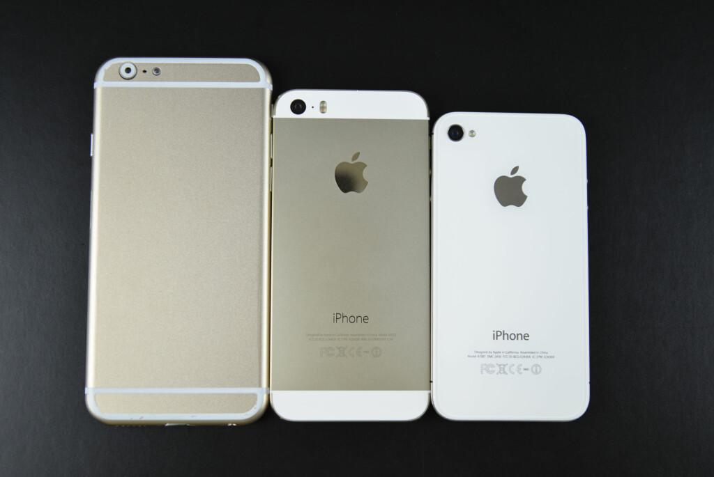 IPHONE VOKSER OPP: Her er en såkalt «mockup av 4,7 tommer store iPhone 6 ved siden av en 4 og 3,5 tommers iPhone. Foto: SONNY DICKINSON