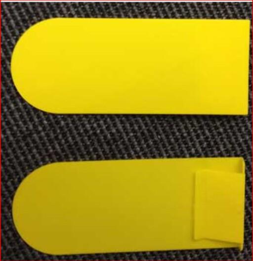 Dette er de gule klipsene du skal sette på postkassen, om du har brev å sende. Foto: Posten