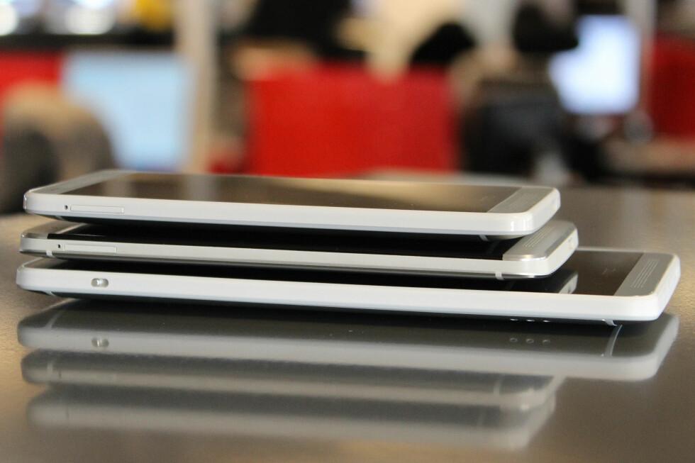 <strong>GIGA:</strong> Fra toppen ser du HTC One Mini, HTC One og gigantiske HTC One Max. Forskjellen mellom de to øverste er ikke voldsom, men den tredje skiller seg kraftig ut.  Foto: Ole Petter Baugerød Stokke