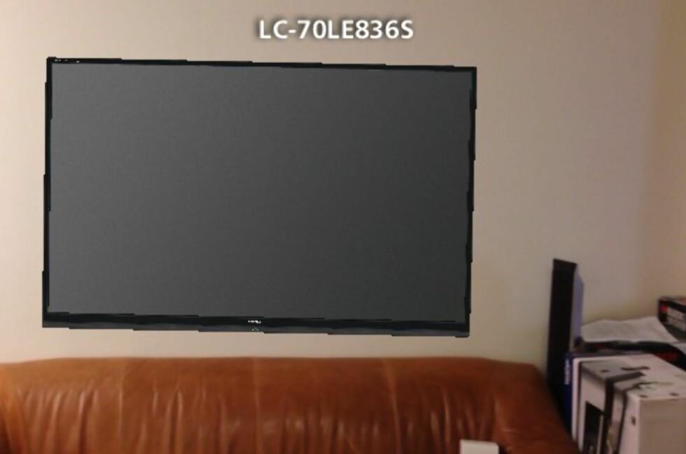 Slik ville det sannsynligvis sett ut om vi var så dumme at vi hang opp en 70-tommers TV rett over treseteren vi har stående på roterommet. Foto: Produsenten/Gaute Beckett Holmslet