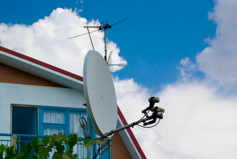 parabolic antenna on the background of sky and clouds Foto: Colourbox