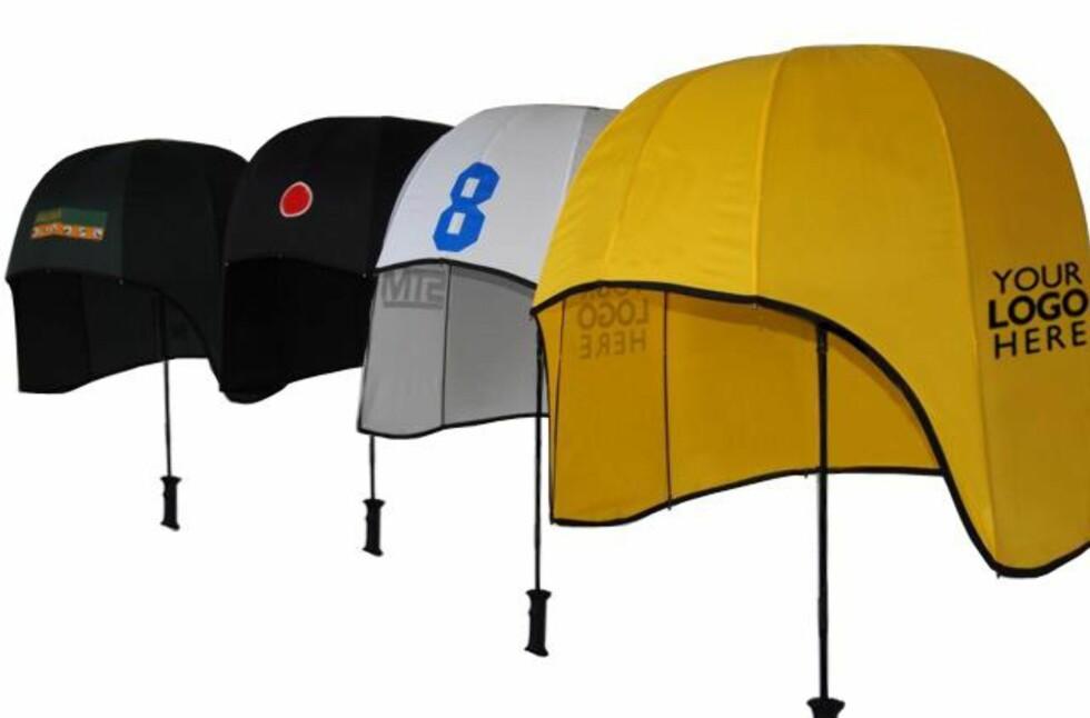 EN SLAGS HATT: Denne utradisjonelle paraplyen lover blant annet å være fullstendig vindsikker. Foto: Rainshader