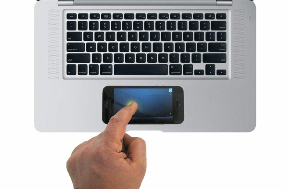 Tenk deg at PC-en din bare var et skall med skjerm, batteri og tastatur, og at mobilen var selve kjernen med prosessor, minne, programmer, trådløse tilkoblinger og naturligvis også pekeplate - som enkelt dokkes til skallet. Den virkeligheten kan være nærmere enn du tror. NB! Husk at du leste om det på DinSide først :) Foto: Apple/DinSide