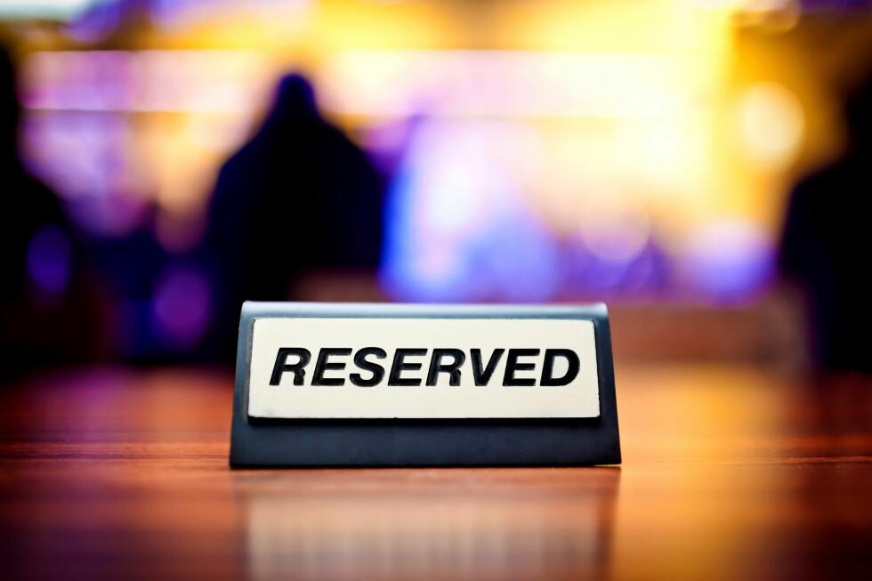 En kjapp telefon til concierge-service, og bordet DU ikke fikk tak i selv er likevel reservert.  Foto: Colourbox