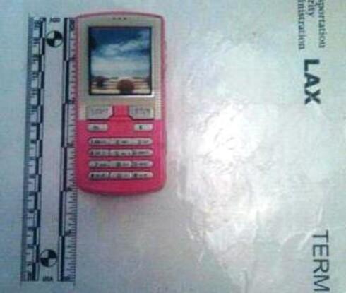 Nei, det er altså ikke en søt, liten mobil, men en elektrosjokkpistol. Foto: TSA