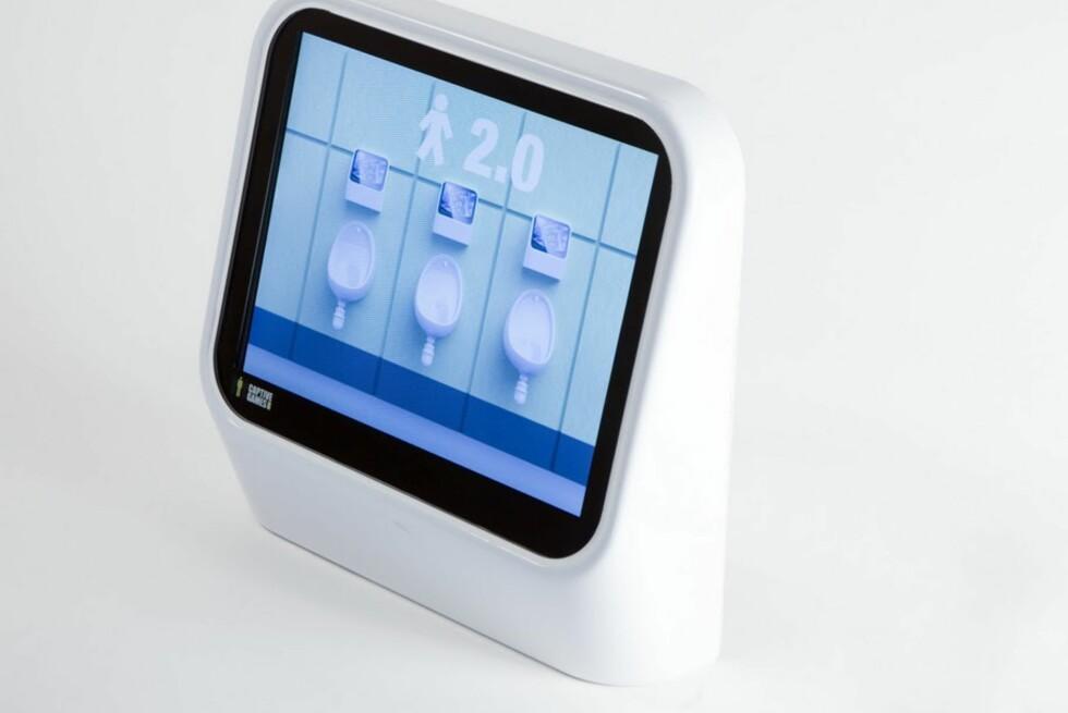Spill ivei ... uten hender. Det siste til underholdningsbruk på utestedene er interaktive tissespill montert ved urinalet. Foto: Captive Media