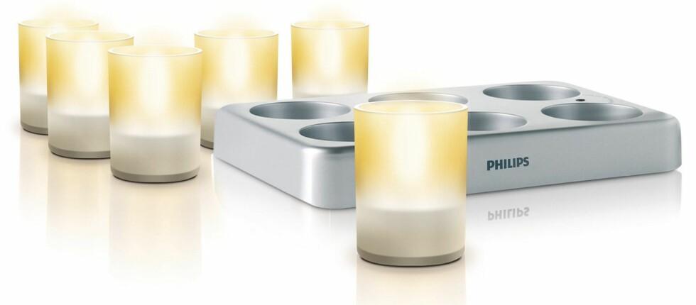 Alle de seks telysene og ladestasjonen til Philips-settet. Her lader du altså alle lysene på en gang. Foto: Produktbilder - Philips