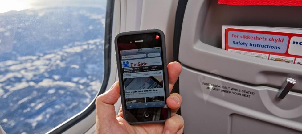 RING, RING: Du kan allerede surfe på nettet om bord i snart halvparten av alle flyene til Norwegian. Fra tirsdag av kan du ringe fra marsjhøyde. Men foreløpig bare om du har iPhone. Foto: Per Ervland