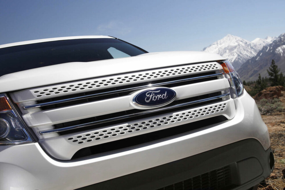2011 Ford Explorer: Behind the three-bar grille, Explorer features a composite bolster supporting the radiator.  This innovative component saves weight - and fuel - while reducing manufacturing complexity.