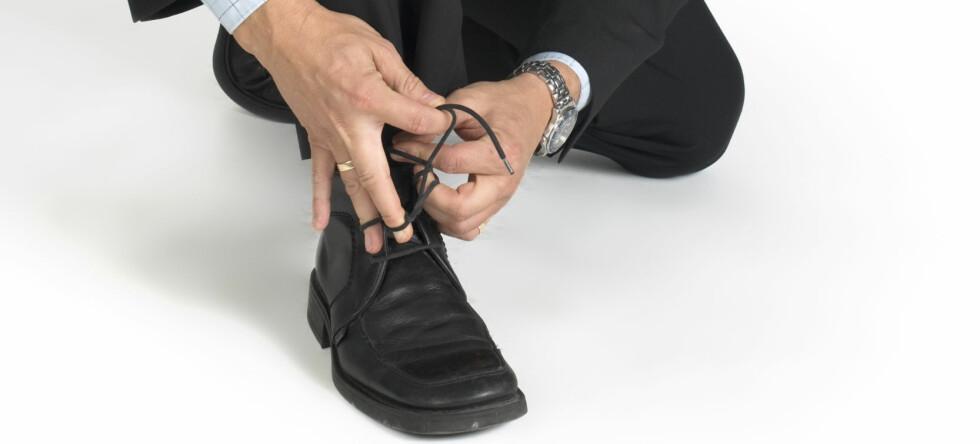 Sko og støvler kan nå bli skannet på sikkerheskontrollen slik at de fleste slipper å ta av seg. Køene vil dermed gå mye raskere.  Foto: Colourbox
