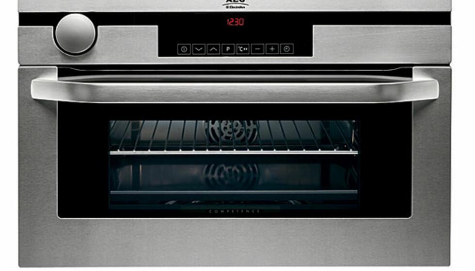 AEGs ovn, KB9820E, til å bygge inn i kjøkkeninnredningen er er ikke for noen som har like lite i lommeboka som de har antall kvadratmeter. 18.000 koster det lekre vidunderet til å bygge inn i kjøkkeninnredningen.
