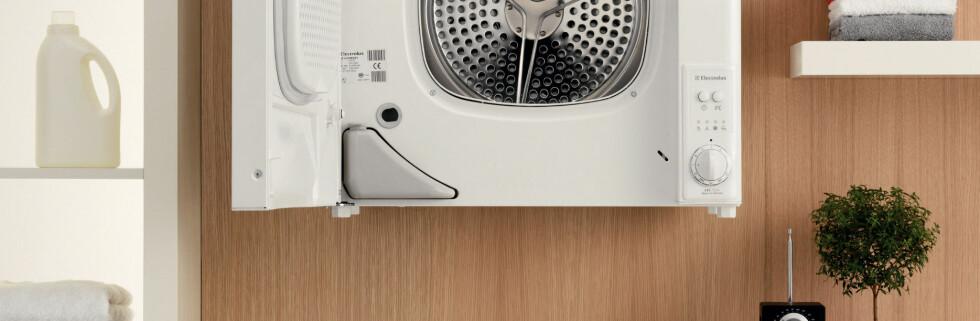 Små hvitevarer til å henge opp på veggen er siste nytt. Denne vegghengte tørketrommelen kommer fra Electrolux, men er ennå ikke å få kjøpt i Norge.  Foto: Electrolux