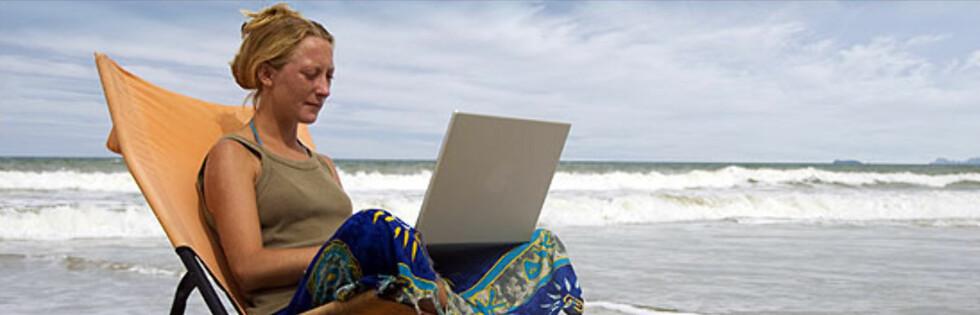 Vil du ha full oversikt over økonomien i ferien? Nye nettbankløsninger gjør det enklere. Illustrasjonsfoto: William Casey/iStock.com