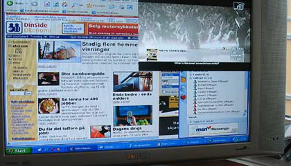 Surfing på dinside.no, messenger til høyre - og et stort TV-bilde øverst til høyre.