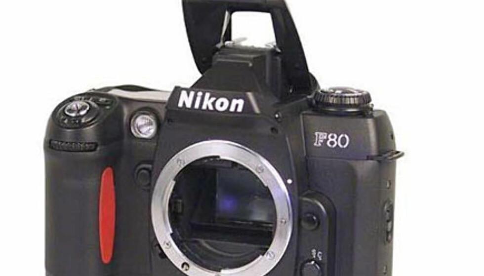 <center>Nikon F80.