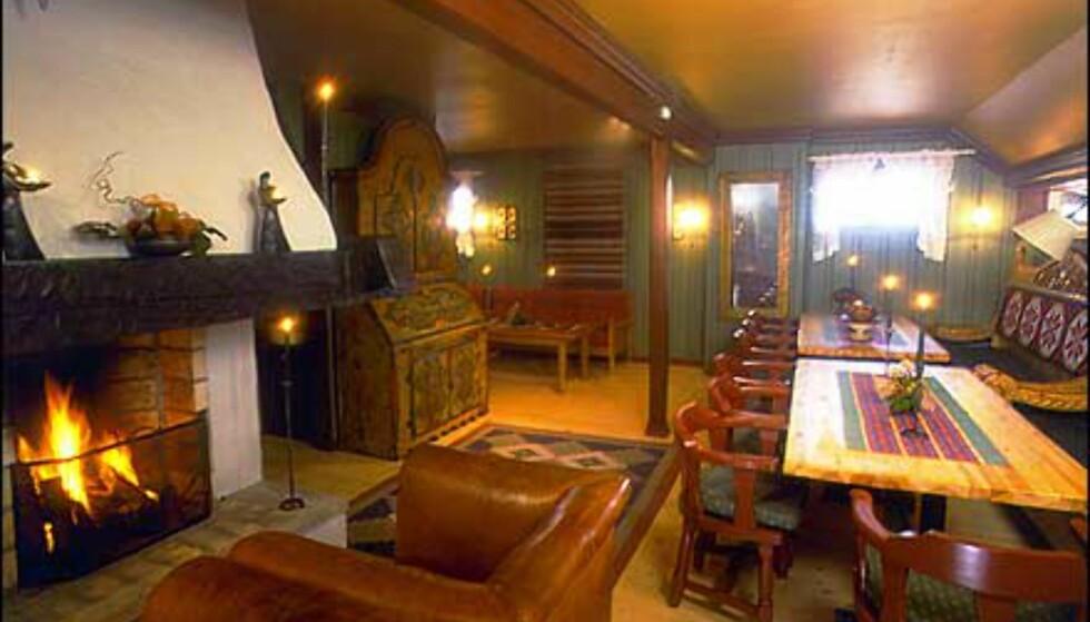 Innvendig sjarm i andre etasje på Husos gjestehus. Rommet brukes for eksempel til kaffeservering under selskaper. Foto: Huso/Pers Foto: Huso/pers