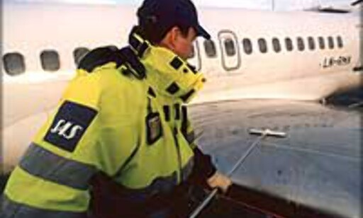 Avising av vingene på et SAS fly.  Foto SAS