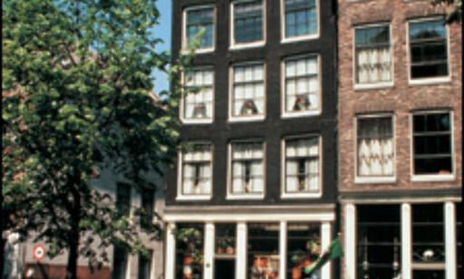 De smale kanalhusene er typiske for Amsterdam. Foto: Visit Holland Foto: Visit Holland