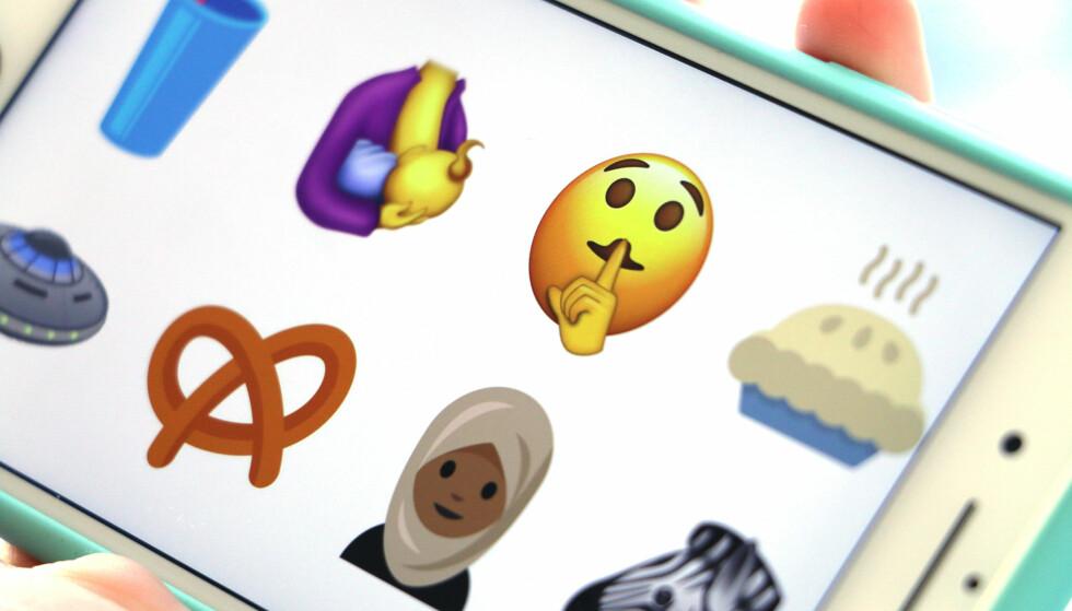MENNESKER OG MAT: Det er mange forskjellige slags type nye emojier som kan dukke opp i løpet av neste år. Foto: Kirsti Østvang