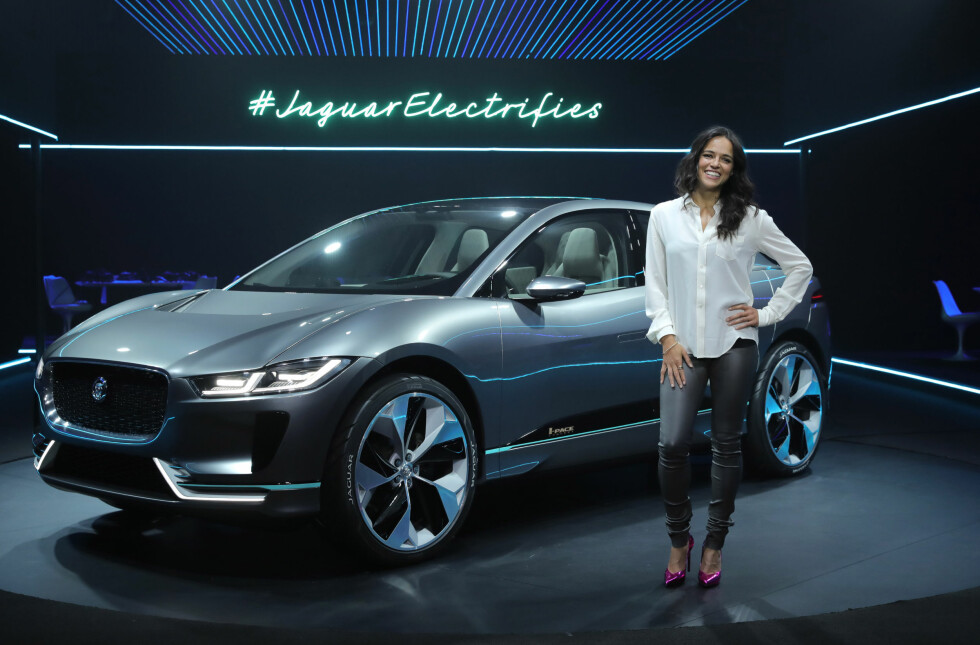DISTRIBUTED FOR JAGUAR LANDROVER - Actress Michelle Rodriguez poses in front of Jaguar's first fully electric vehicle, the Jaguar I-PACE concept car, which was revealed for the first time in Los Angeles, on Monday, November 14, 2016. The Jaguar I-PACE Concept car is the start of a new era for Jaguar.  This is a production preview of the Jaguar I-PACE, which will be revealed next year and on the road in 2018.  Customers can register now at jaguar.com to be one of the first I-PACE owners. (AP Images for Jaguar Landrover)