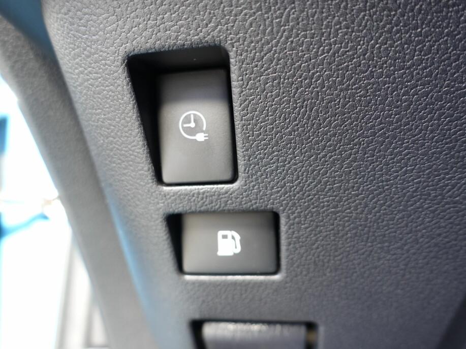 KNAPP ELLER APP: Denne knappen eller appen er essensiell for å få lang rekkevidde. Oppgir du ønsket tid for avreise, står nemlig batteriet både fulladet og oppvarmet fra nettstrømmen.