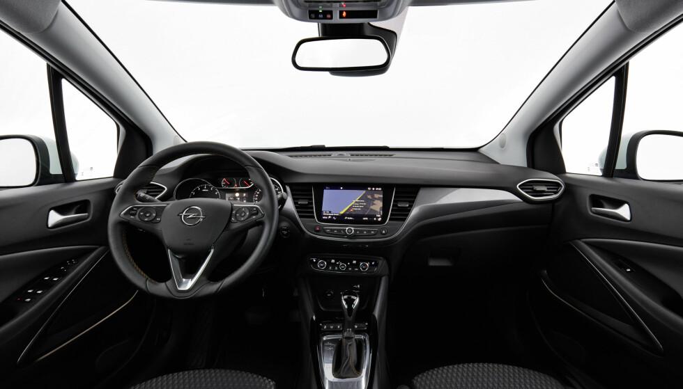VELG PREMIUM: Bedre seter og integrert navigasjonsamt LED lykteteknologi er verdt prisforskjellen. Foto: Opel
