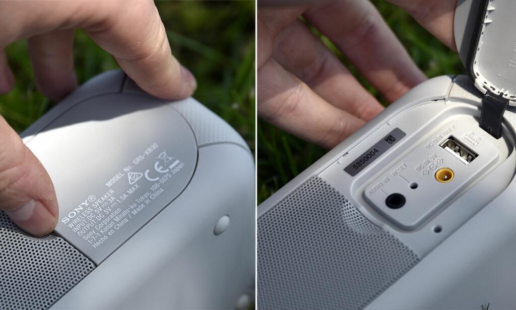 LOKK: På baksiden finnes et lokk som skjuler ladeporten, AUX-inngang og USB-utgang for lading av mobiltelefon eller lignende. Foto: Pål Joakim Pollen