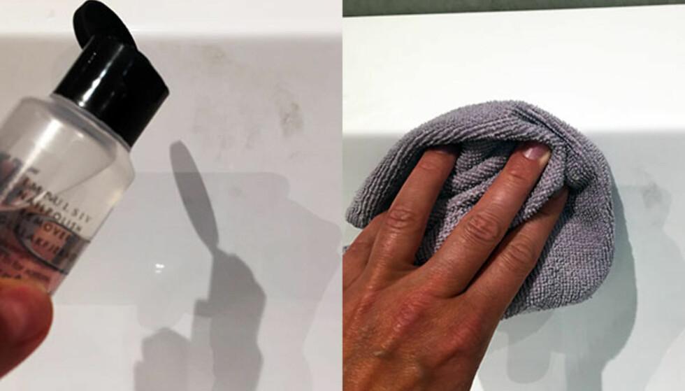 <strong>FØRST:</strong> Påfør neglelakkfjerner på flekken på badekaret. Tørk over flekken med en tørr klut. Foto: Linn M. Rognø.