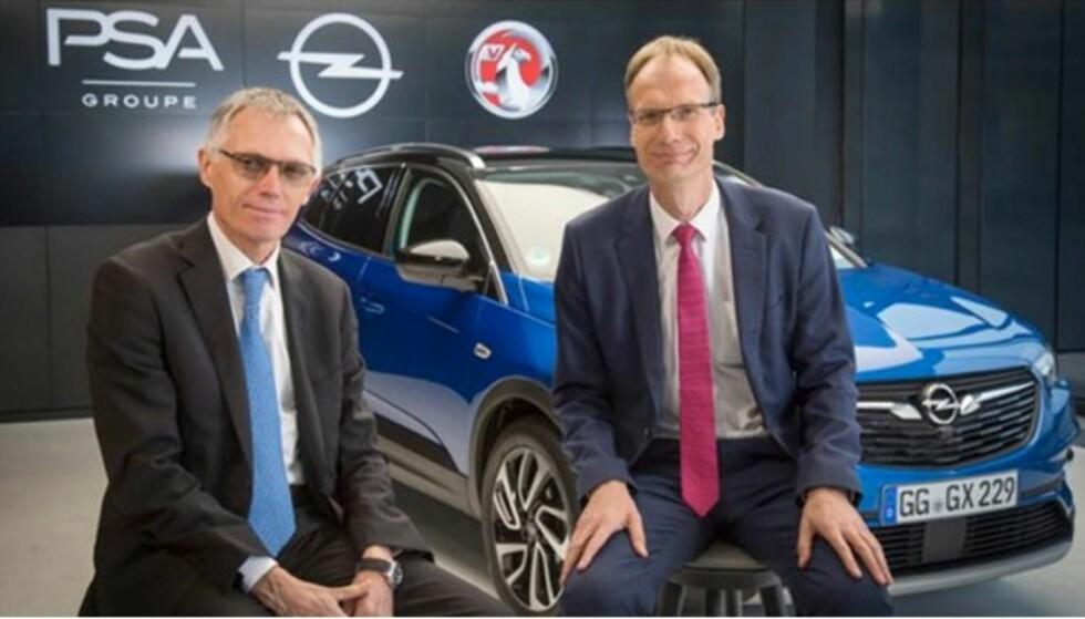 HAR LAGT EGNE PLANER: Administrerende direktør Carlos Tavares i PSA Group og administrerende direktør Michael Lohscheller i Opel Automobile GmbH. Foto: Opel