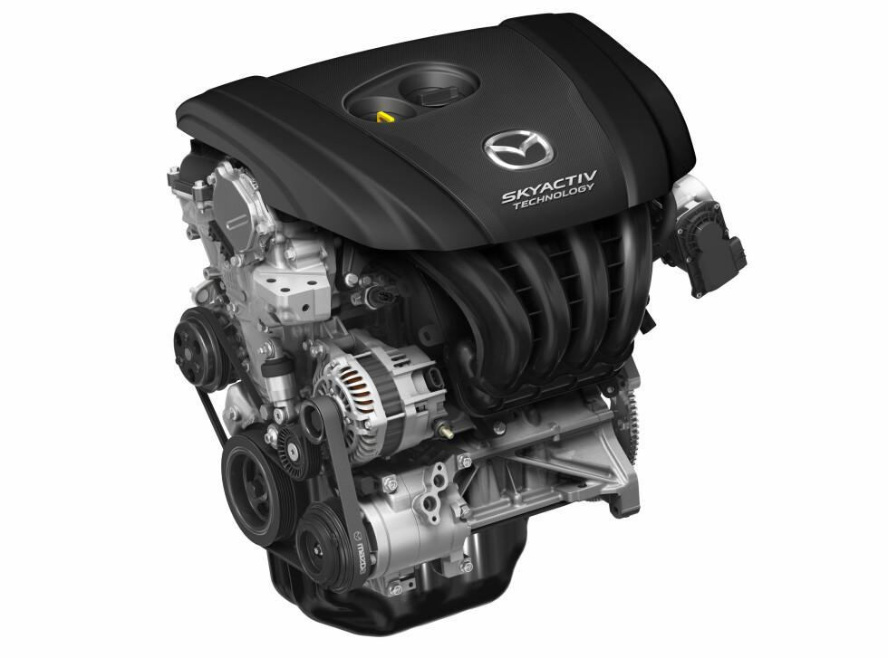 EGNE LØSNINGER: Mazda satser på selvaspirerende motorer, har egne løsninger for hybrid. Neste motorgenerasjon blir en aldri så liten revolusjon i bensinmotorens historie. Foto:  MAZDA