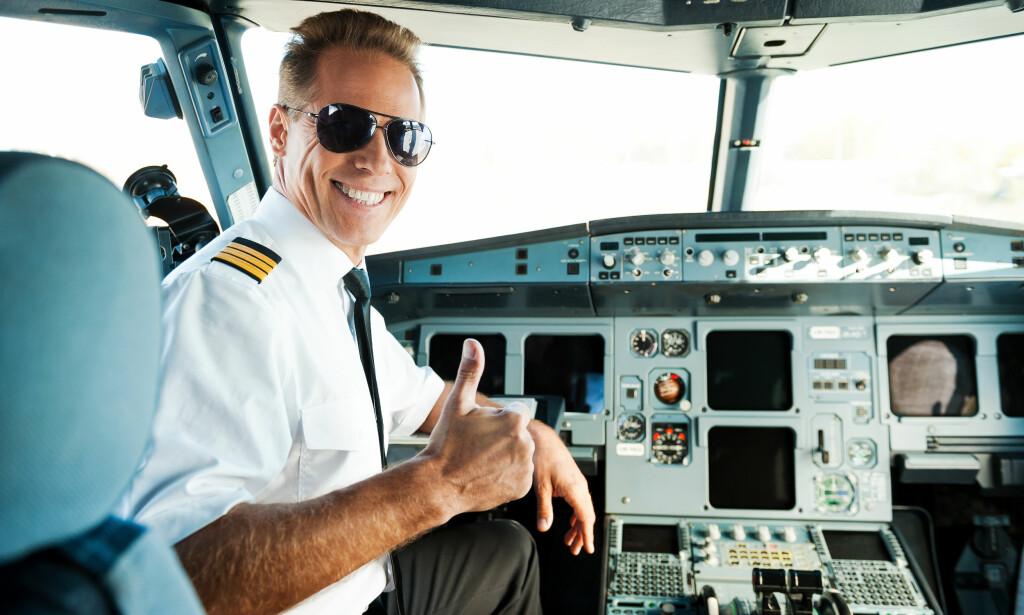 LØNNSVINNER: Piloter er blant de som tjener mest, ifølge SSB. De har en gjennomsnittlig månedslønn på over 70.000 kroner. Foto: Shutterstock/NTB Scanpix