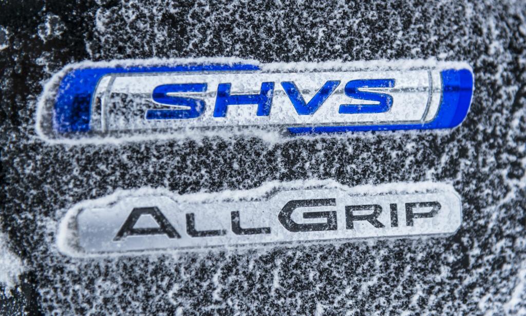 TULLETE: Logoen for hybridsystemet setter trolig større co2 fotavtrykk i produkjson og montering enn det man sparer bensin i spart forbruk: Foto: Jamieson Pothecary