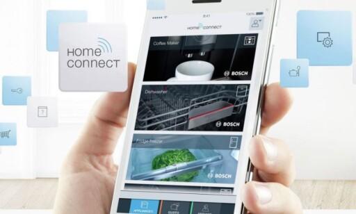 OPPKOBLET: Både ovner, oppvaskmaskiner og vaskemaskiner fra Bosch kan styres fra mobilen. Foto: Bosch