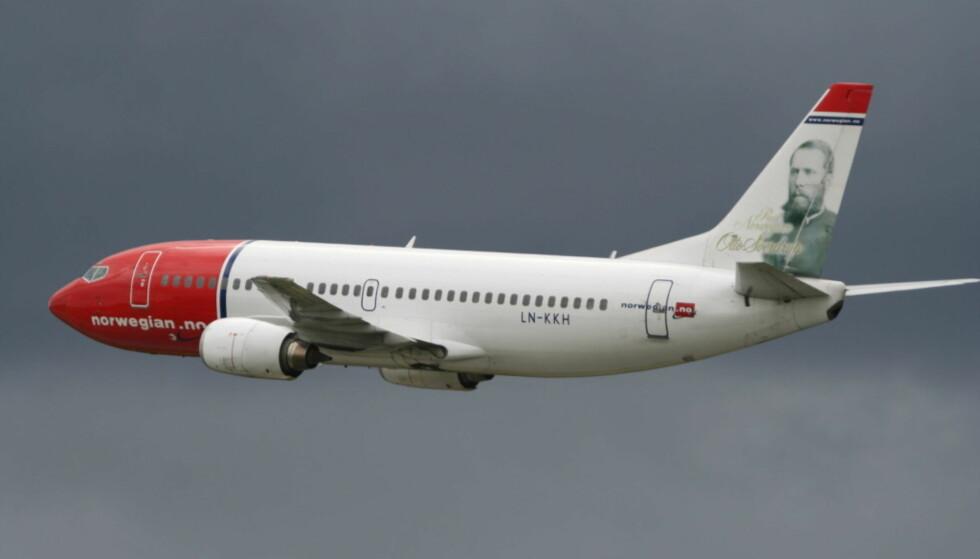 FØRST INN I FLYET? Norwegian testet ut at passasjerer som ønsker å gå ombord først, kan betale for dette. NTB Scanpix