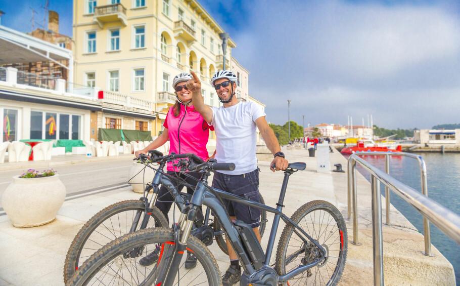 TRYGGHET: Å ta med seg en elsykkel til 30.000 på bytur kan være nervepirrende. Med forsikring som dekker tyveri og hærverk føles det tryggere. Enkelte tilbyr også veiberging. Foto: Moreimages/Shutterstock/NTB scanpix