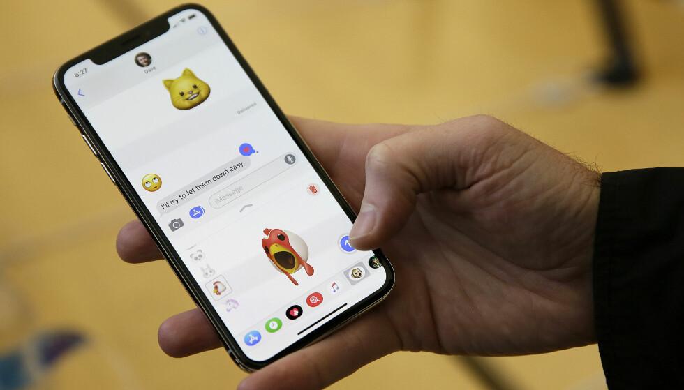 BEDRE MELDINGER: Apple har sluppet iOS 11.4. En av nyhetene er at meldinger nå kan synkroniseres på tvers av iPhone, iPad og Mac. Foto: Eric Risberg/AP Photo/NTB Scanpix)