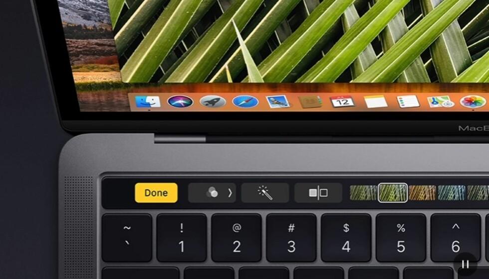 TOUCH BAR: Over tastaturet sitter et berøringsfølsomt felt med knapper som endrer seg med konteksten du befinner deg i. Foto: Apple