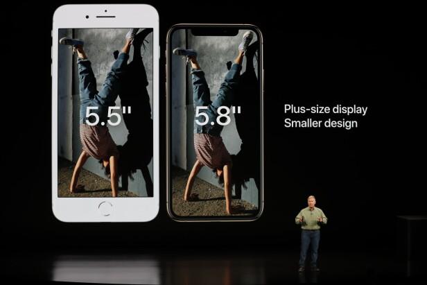 RAMMELØS DESIGN: Vi har lenge klaga over at iPhone har i overkant mye ramme rundt skjermen, noe som har gjort den til større enn den må være. Ved å fjerne hjemknappen, er den saken løst. REUTERS/Stephen Lam
