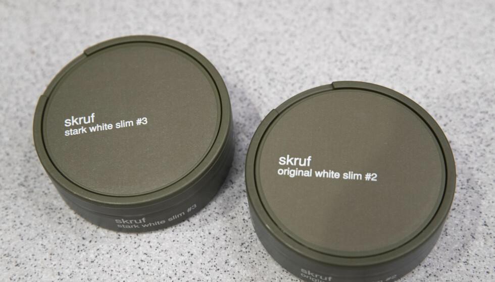 KJØPER LIKE MYE SOM FØR: Nøytrale pakninger på snus og tobakk har ikke påvirket salget på flyplassutsalgene. Foto: Terje Bendiksby / NTB scanpix