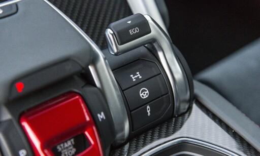 EGO: Du kan velge mellom flere settinger på firehjulsdriften, rattmotstand og stivhet på demperne. Når du er fornøyd, trekker du i Eco-spaken. Da blir dette en snarvei til ditt favorittoppsett. Foto: Jamieson Pothecary